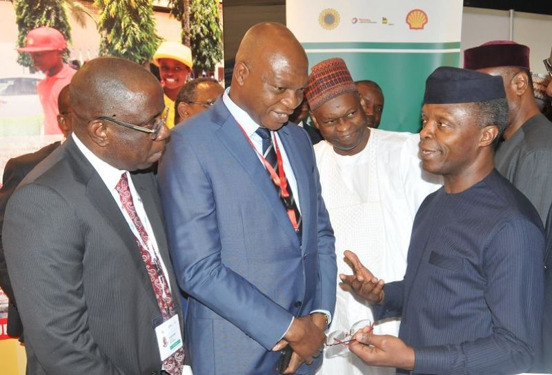 L-R: Managing Director, Shell Nigeria Exploration and Production Company, Bayo Ojulari; and the Managing Director, The Shell Petroleum Development Company of Nigeria (SPDC) Ltd and Country Chair, Shell Companies in Nigeria, Osagie Okunbor, receiving Chairman, Nigeria Economic Summit Group, Bukar Kyari and the Vice President, Prof. 'Yemi Osinbajo at the Shell exhibition stand at the opening of the 23rd Nigeria Economic Summit in Abuja... on Tuesday, Oct. 10, 2017.