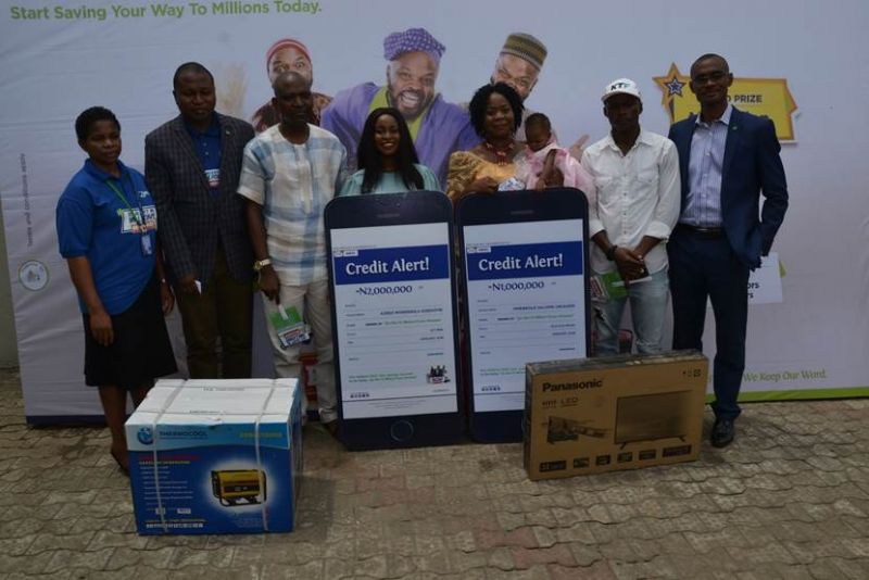 L-R Head, Savings Group, Fidelity Bank Plc, Janet Nnabuko; Divisional Head, Retail Banking, Fidelity Bank Plc. Richard Madiebo; Winner of a generating set, Ranmilowo Olaniyi,; Winner of N2 million and  a student of Federal University of Agriculture, Abeokuta (FUAAB), Azeez Morenike Adedoyin;  Winner of N 1 million, Mmereole Salome Obiageri,; winner of a television set, Joe Henry Chioma and Regional Bank Head, Festac, Fidelity Bank Plc., Paschal Nzeribe, at the 4th Monthly /2nd Bi-monthly  Prize Presentation of Fidelity Get Alert In Millions Promo Reloaded in Ojo, Lagos recently.