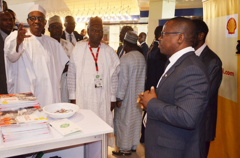L-R: President Mohammadu Buhari; Chairman, Nigeria Economic Summit Group, Mr. Bukar Kyari; and  Head of Nigerian Content Development of Shell Nigeria Exploration and Production Company (SNEPCo), Mr. Austin Uzoka, during the president's tour of Shell's stand at the opening ceremony of the 2016 Nigeria Economic Summit in Abuja… on Monday, Oct. 10, 2016.