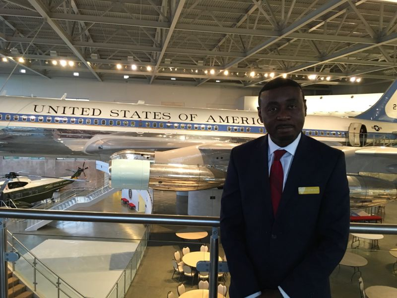 Sam Okey Mbonu at reagan library with airforce one background.