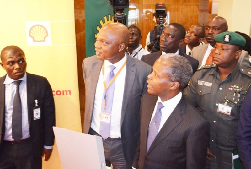 Managing Director of The Shell Petroleum Development Company of Nigeria Ltd and Country Chair, Shell Companies in Nigeria, Mr. Osagie Okunbor (2nd left), conducting Vice President Yemi Osinbajo round the Shell exhibition stand at the ongoing 21st Summit of the Nigeria Economic Summit in Abuja… on Tuesday, Oct. 13, 2015.