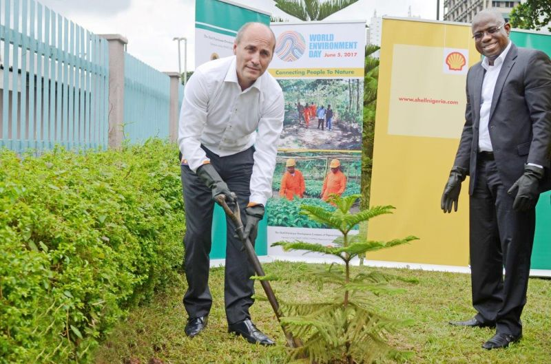 From left: Vice President Shell Nigeria and Gabon, Peter Costello, and Managing Director, Shell Nigeria Exploration and Production Company Limited (SNEPCo), Bayo Ojulari, plant a tree at the Marina area of Lagos in commemoration of World Environment Day on June 5.