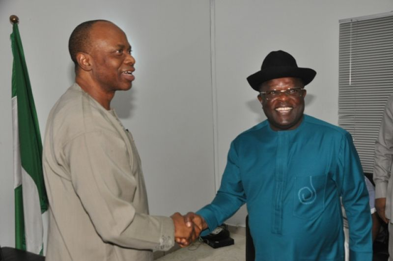 R-L: Governor David Umahi being congratulated on his electoral victory at the Supreme Court by his Ondo State counterpart and Chairman of the Peoples Democratic Party Governors Forum, Dr. Olusegun Mimiko, shortly before the PDP Governors Forum meeting in Abuja . . . on Wednesday night, January 27, 2016. Photo: Ebonyi State Government.