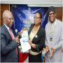 L-R: Past District Governor, Rotary International District 9110, Dr. Kamoru Omotosho presenting bannerette of Rotary Club of Ikoyi to the Guest Speaker, Dr (Mrs) Felicia Mogo, Deputy Director/Head Marine Environment Management Department, Nigeria Maritime Administration & Safety Agency (NIMASA) with the President, Rotary Club of Ikoyi, Rotarian Isichei Osamgbi after she delivered a lecture on