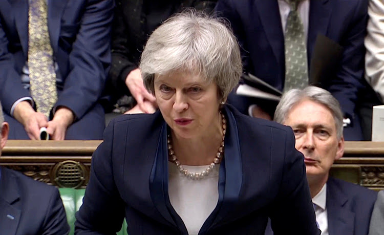 British PM faces no-confidence vote after huge defeat