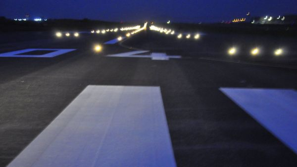 •Abuja Airport runway at night.