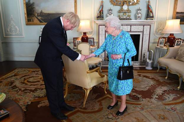•Britain's new PM Boris Johnson shakes the Queen, as he asks for her permission to form a govern