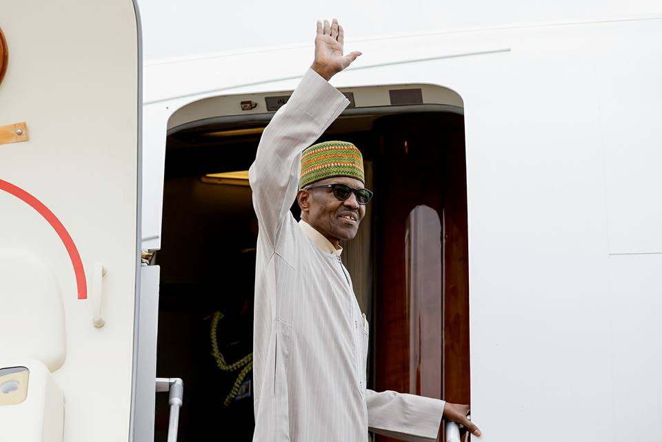 •President Buhari while leaving for a previous trip