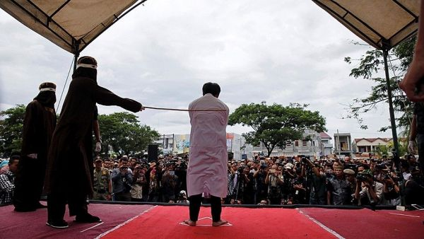 •One of the Indonesian Christians being whipped for violating Islamic sharia law. Photo: Reuters.