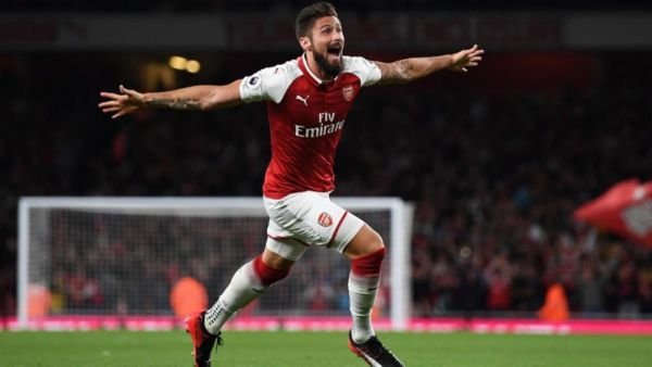 English Premiership back with a bang; Arsenal triumph over stubborn Leicester in thrilling opener