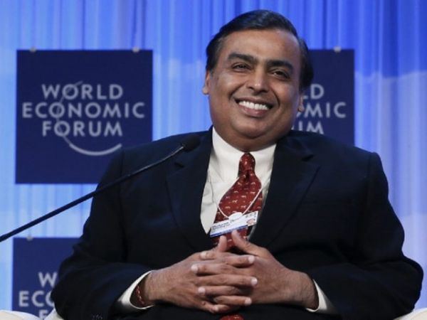 India's richest man wins telecom war, buys out billionaire rival