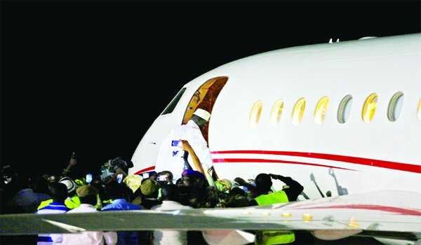 •Jammeh boarding the Falcon Jet on his way into exile in Equatorial Guinea...Saturday night.
