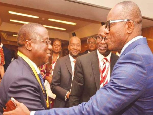 •Kachikwu (right) and Baru exchanging pleasantries on Tuesday in Abuja.