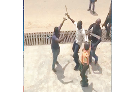 •Photo shows LAGESC official (in yellow) attacking a resident with machete
