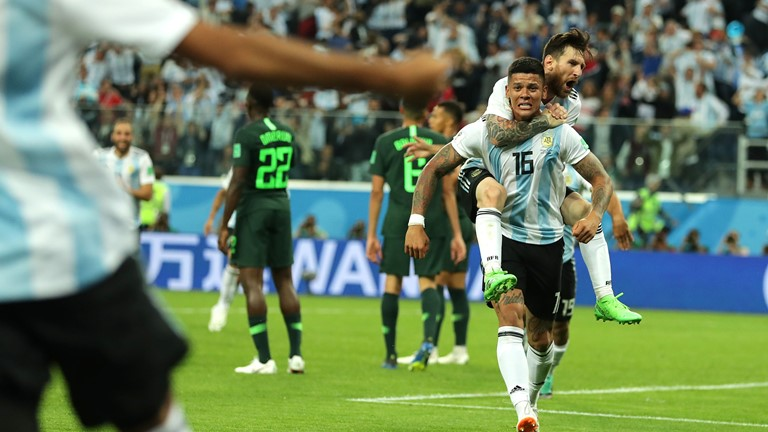 •Marcus Rojo and Lionel Messi after Rojo volleyed the winner against Super eagles