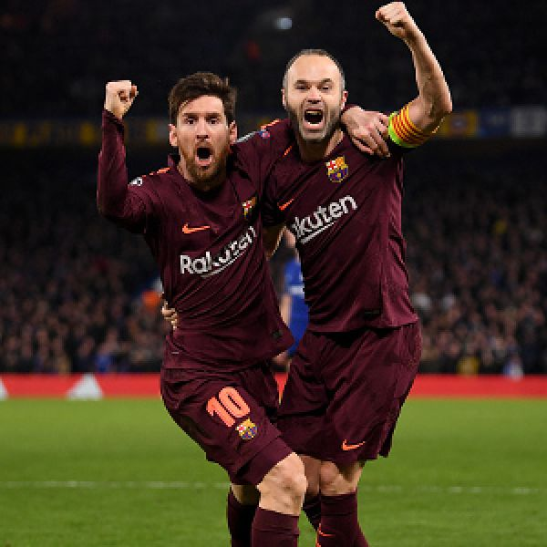 •Messi (L) and Barca teammate celebrating . . . last night at Stamford Bridge