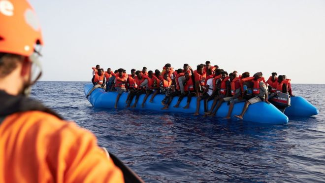 •Migrants at sea. Photo: AFP.