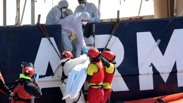 •Emergency workers assisting troubled migrants on the Mediterranean.
