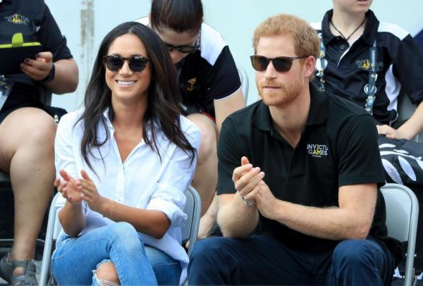 •Prince Harry and fiancée Meghan Markle
