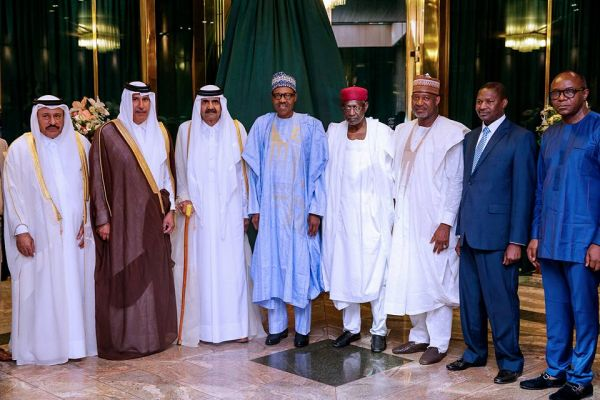 •President Buhari and close aides with Sheikh Hamad Bin Khalifa Al-Thani and delegation