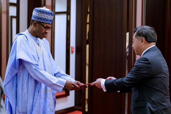 •President Buhari receiving Letter of Credence from Singapore's High Commissioner to Nigeria, Li