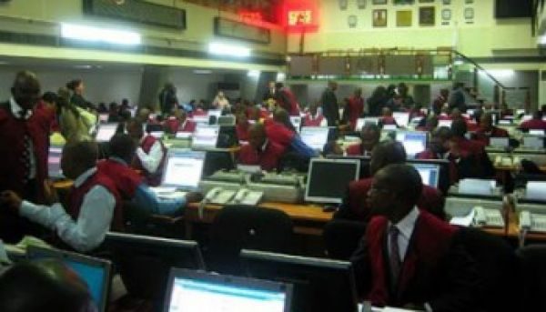 •Stock traders on the floor of the NSE