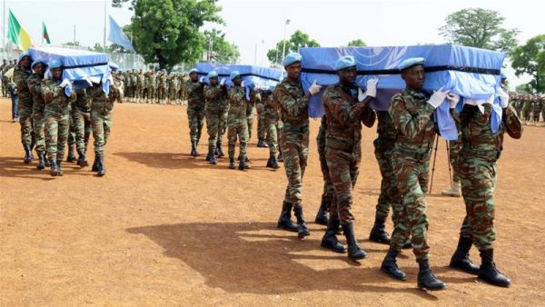 •Funeral for UN peacekeepers. Photo: Moustapha Diallo/Reuters