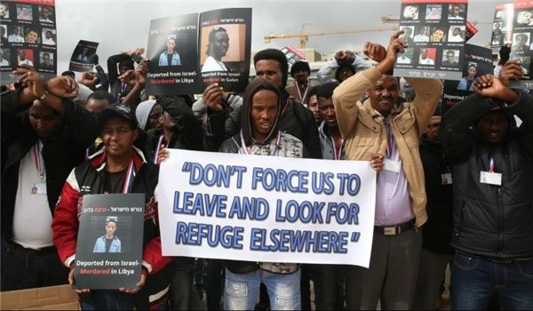 •Demonstrating African migrants and asylum-seekers in Israel