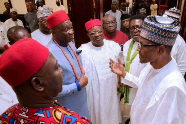 •President Buhari and Governor Umahi exchanging pleasantries.