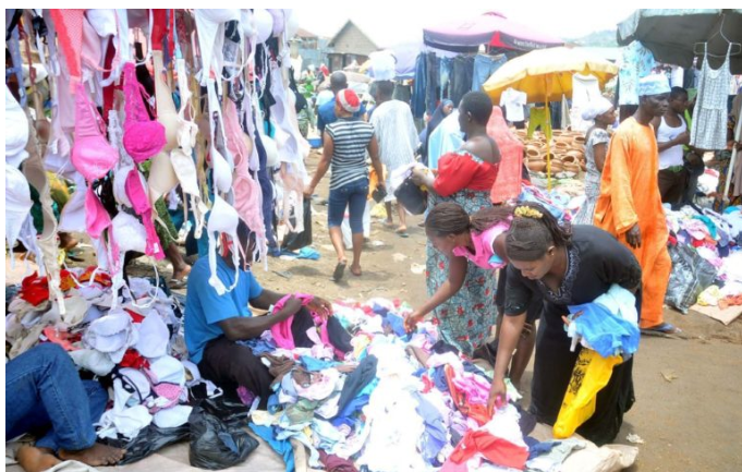•Women busy selecting fairly-used underwear in the market