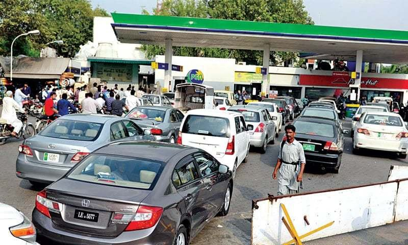 •Cars queue for fuel at a filling station