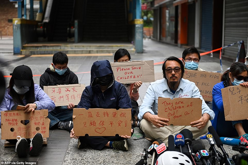Hong Kong university protesters defy surrender warnings