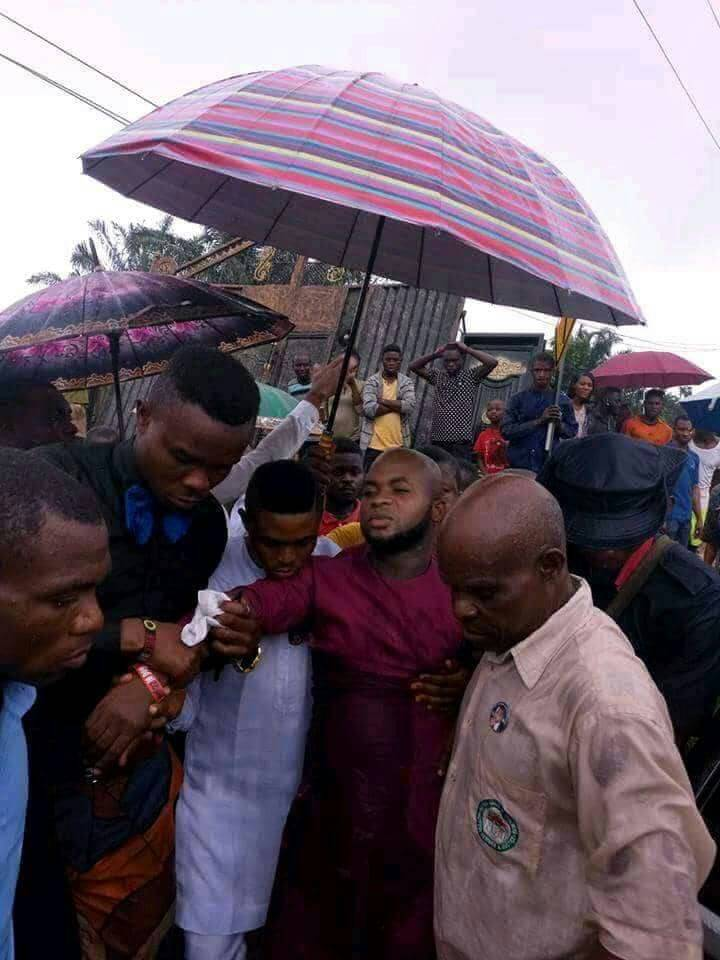 •Pastor David Elijah Chidiebere being assisted by church members after being shot